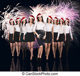 Group of business women on the fireworks background
