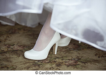 shoe of the bride - White shoe of the bride in white dress