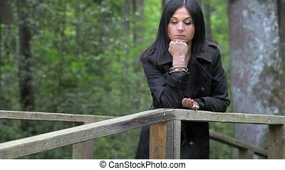 Depressed woman on the bridge