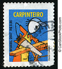 postmark - BRAZIL - CIRCA 2007: The worker saws a board,...
