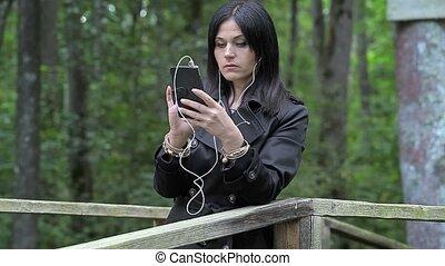 Women listen to music on the bridge