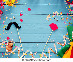 Fun photo booth accessories festive background with a loving...