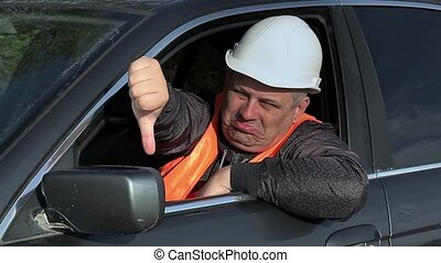 Worker in car showing thumb down