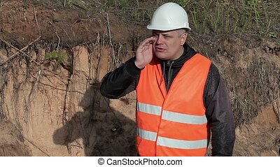Worker screaming at outdoor in sand pit