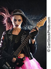 Rock princess playing the guitar