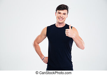 Smiling sports man showing thumb up