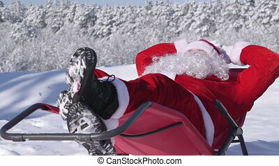 Santa Claus enjoying frosty sunny day in snow covered winter forest