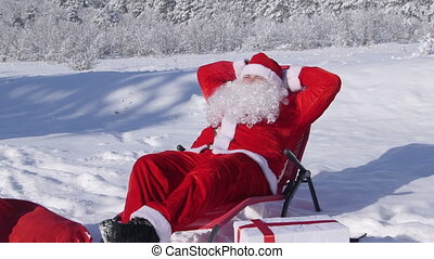 Santa Claus enjoying frosty sunny day in snow covered winter...