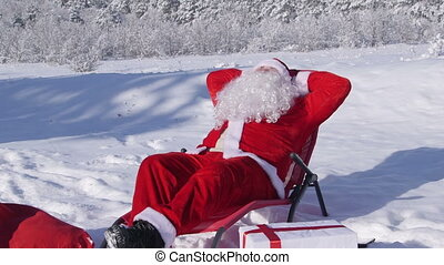 Santa Claus relaxing in the snow