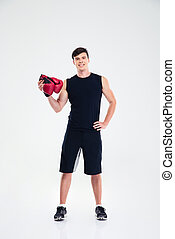 Fitness man holding boing gloves - Full length portrait of a...