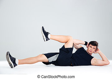Athletic man doing abdominal exercises