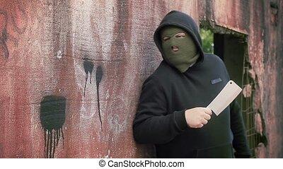Man with knife hidden near the buil