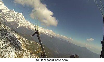 pov Paragliding in the sky Annapurna Pokhara, Nepal,...