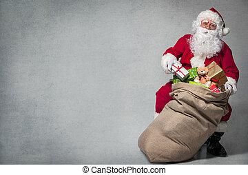Santa Claus with a bag of presents - Santa Claus with a bag...