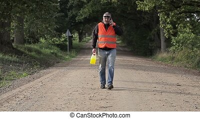 Man walking away with plastic can