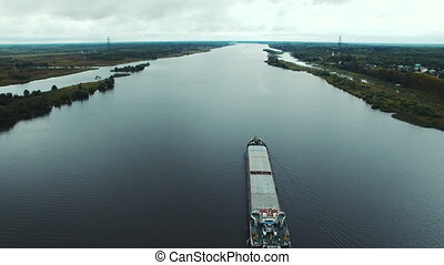Aerial view of oil tanker ship sailing on river, Volga