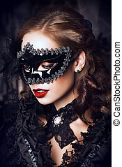 immortal - Charming mysterious girl in black mask and black...