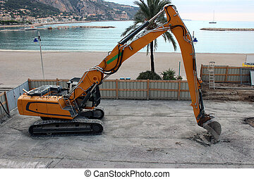Crawler Excavator on a construction site near the beach in...