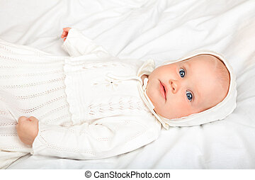 Child in baptismal clothes - Close-up shot of six month baby...