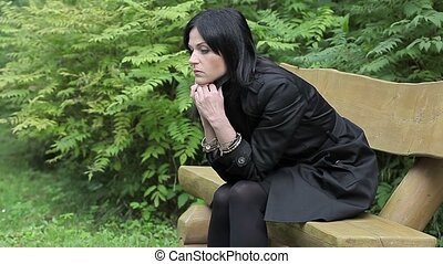 Depressed woman on bench