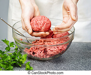 Cooking with ground beef - Chef making hamburgers in kitchen...