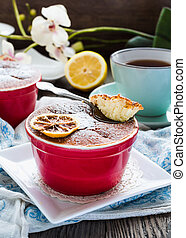 lemon pudding with red plates on a white tablecloth