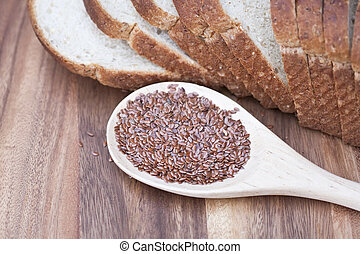 Flax seed and flax bread. Shallow DOF.
