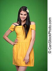 Lovely girl in yellow strapless dress feeling shy