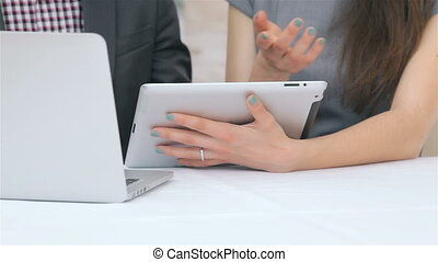 Close-up of hands of young attractive business man and woman...