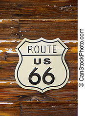 Route 66 road sign in Arizona on wooden wall