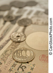 Japanese currency - Japanese coins on Yen notes close up...