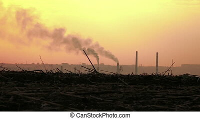 Smoke from pipes at sunset - Early spring chamber on railway...