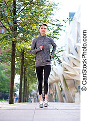 Healthy woman running outdoors in the city - One healthy...