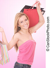 Shopping women smiling - A Shopping women smiling. over pink...