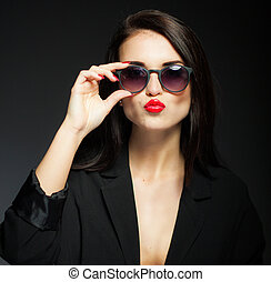 Glamour woman with sunglasses, jacket and red lips -...