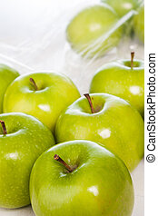 Green apples closeup isolated