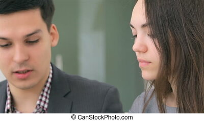 Close up face young attractive business man and woman -...