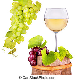 Glass of white wine with grape on a wooden barrel - Glass of...