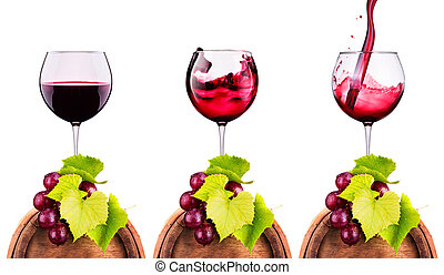 Glass of red wine with grape on a wooden barrel - Glass of...