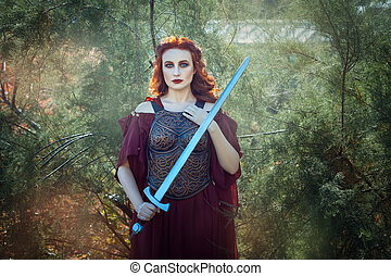 Girl with fiery hair warrior. In her hand she holds a sword.