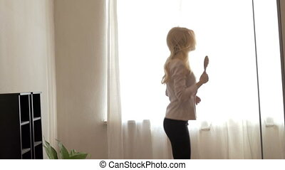 Beauty Teenage Girl Dancing at Home. Looking in Mirror....