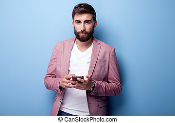 Handsome young man using mobile phone.