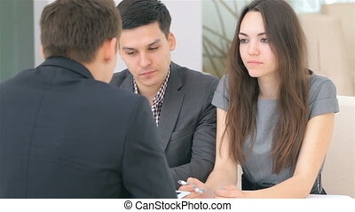 Couple consults about their business project, at the...