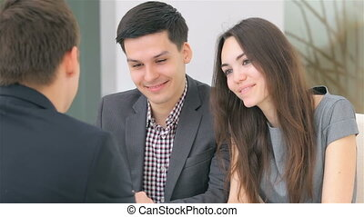 Business project - Young attractive couple consults about...