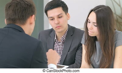 Business analyst - Young attractive couple consults about...