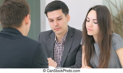 Young attractive couple consults about their business...