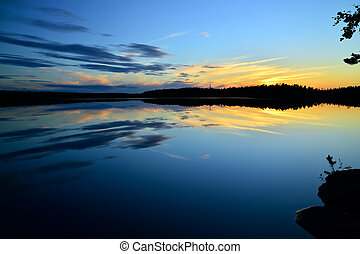 Northern white nights on the lake Pongoma. Karelia, Russia -...