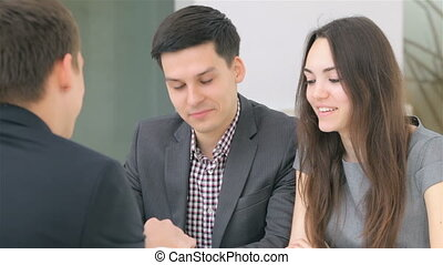 Couple consults about their business - Young attractive...