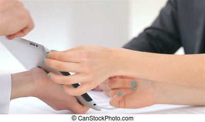Close-up of hands, young attractive couple customer consults...