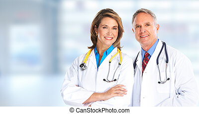 Mature doctors over blue background - Smiling medical...